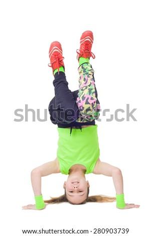 Happy little girl dancing break dance isolated on white background - stock photo