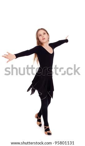 Happy little girl dancing, isolated - stock photo
