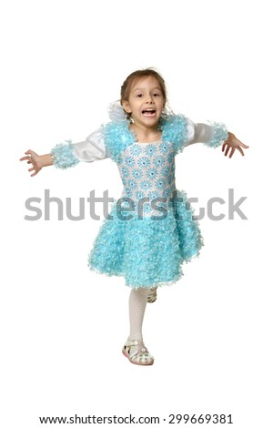 Happy little girl dancing on a white background - stock photo