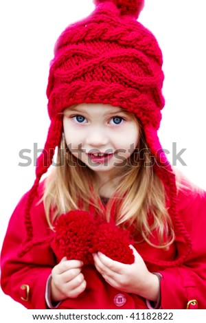 Happy little girl dressed for winter - stock photo