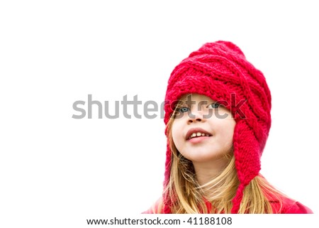 Happy little girl dressed for winter with copy space. - stock photo