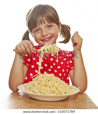 happy little girl eating spaghetti