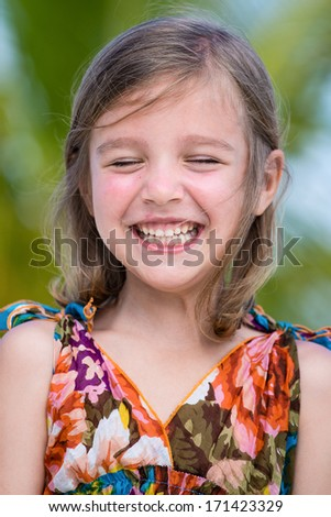 Happy little girl enjoy summer day at the beach - stock photo