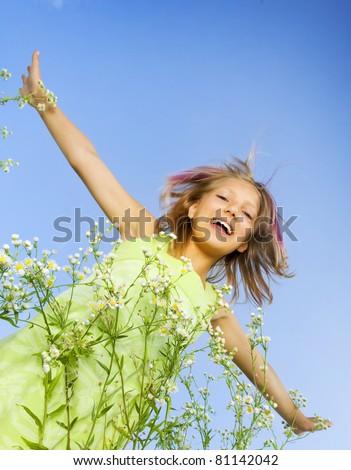 Happy Little Girl flying.Outdoors - stock photo