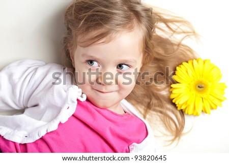 Happy little girl giving flowers. - stock photo