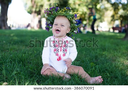 Happy Little Girl having Fun at the Summer Park. Cute Child with Flowers Wreath. Healthy Kids. Vintage Photo Effects