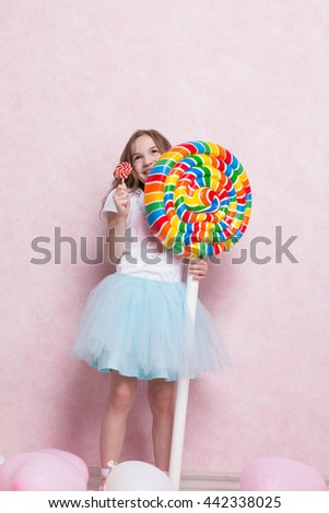 Happy little girl hold huge lollipop candy. Concept of happy - stock photo