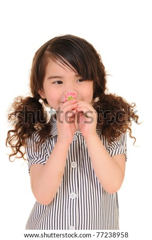 Happy little girl holding a carnation. Isolated on white background - stock photo