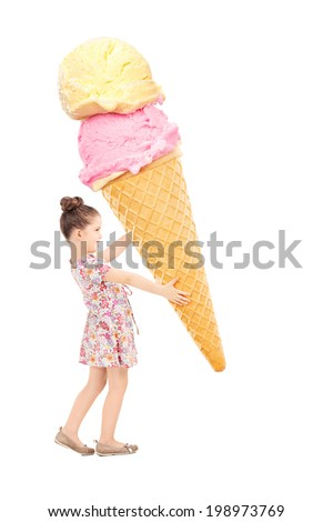 Happy little girl holding a huge ice cream isolated on white background - stock photo