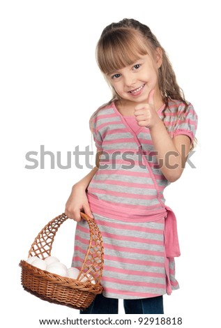 Happy little girl holding basket of eggs and giving you thumb up over white background - stock photo