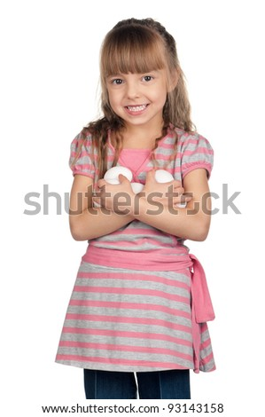Happy little girl holding eggs over white background