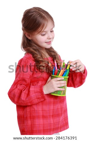 Happy little girl holding pencils/Studio portrait of a beautiful cheerful little girl with colored pencils on Education - stock photo