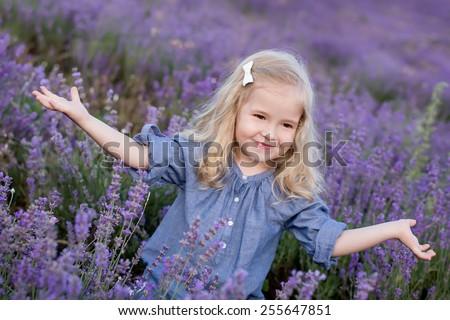 happy little girl in a lavender field - stock photo