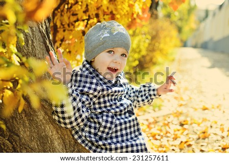 happy little girl in fall - stock photo