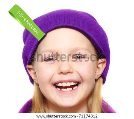Happy little girl in hat with fabric label 100% natural, isolated - stock photo