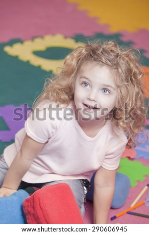 Happy little girl in kindergarten - stock photo