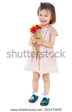 happy little girl in pink dress with flowers isolated view of a white background.Photo in kindergarten,active lifestyle,happiness concept,carefree childhood concept.