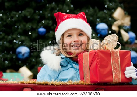 Happy little girl in Santa Claus sledge - stock photo