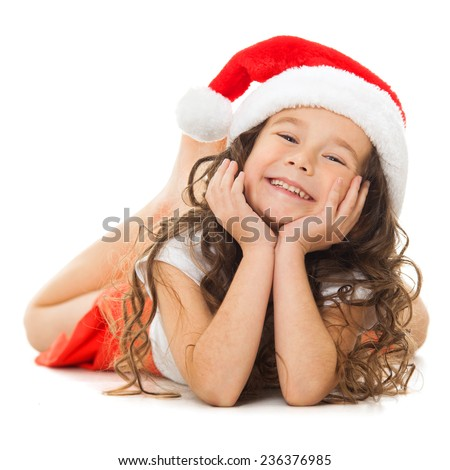 Happy little girl in Santa hat. Isolated on white background. Holidays, christmas, new year, x-mas concept. - stock photo