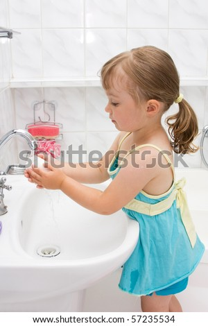 happy little girl in toilet - stock photo