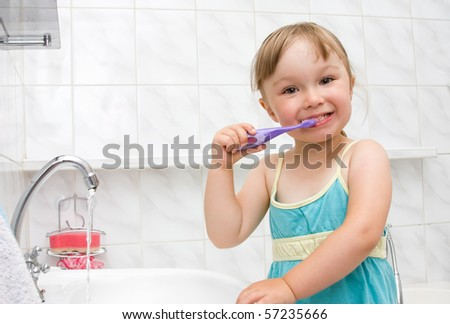 happy little girl in toilet