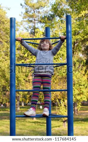 happy little girl on playground - stock photo