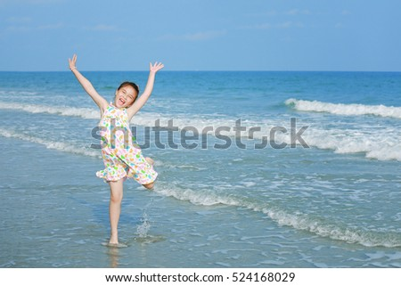 Happy little girl on the beach