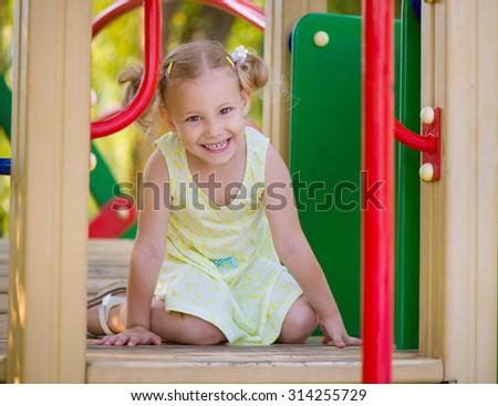 Happy little girl play joyful at playground - stock photo