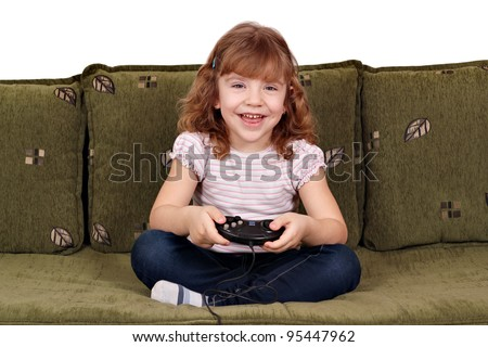 happy little girl play video game - stock photo