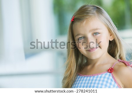 Happy little girl portrait - stock photo