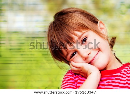 Happy little girl portrait indoor - stock photo