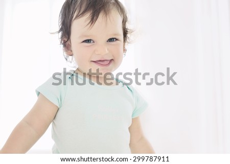 Happy little girl portrait on white background. Baby looking to camera - stock photo