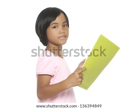 happy little girl reading a book