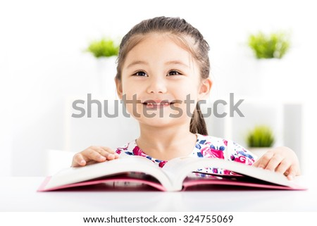 happy little girl Reading a Book - stock photo
