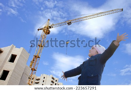 Happy little girl rejoices build a new home for his family - stock photo