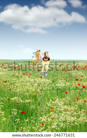 happy little girl running in the spring meadow - stock photo