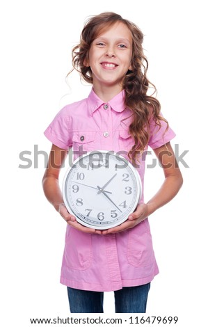 happy little girl showing clock and smiling. studio shot over white background - stock photo