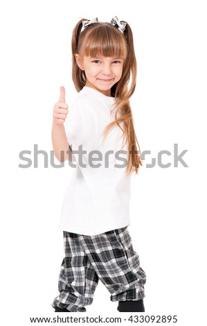 Happy little girl showing thumbs up gesture, isolated on white background - stock photo