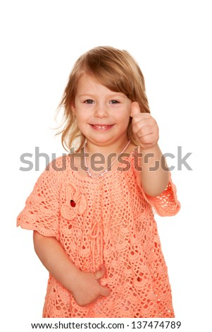 Happy little girl showing thumbs up. Isolated on white background - stock photo