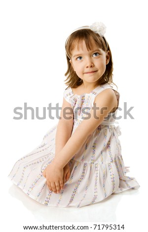 Happy Little girl sitting isolated on white