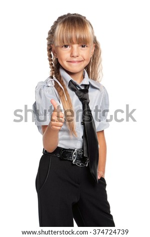 Happy little girl. Smiling little girl showing thumbs up, isolated on white background. - stock photo