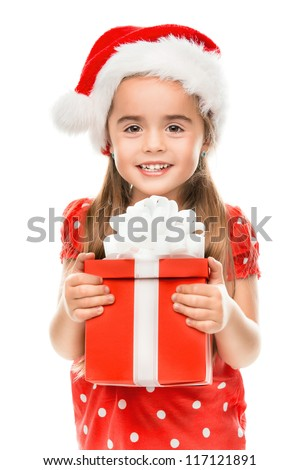 Happy little girl smiling with gift - stock photo