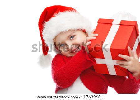Happy little girl smiling with gift box. - stock photo