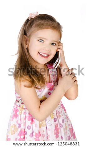Happy little girl speaking by cell phone isolated on white - stock photo