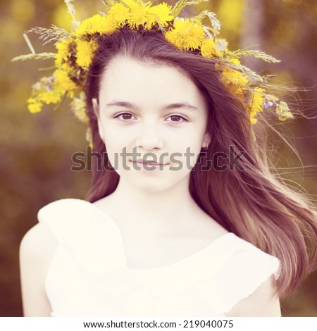 Happy little girl standing in the park. - stock photo