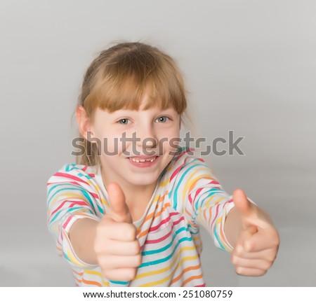 happy little girl thumbs up - stock photo