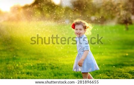 happy little girl walks in the park - stock photo