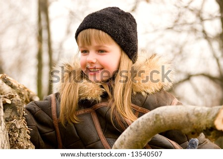 Happy little girl wearing winter clothes - stock photo