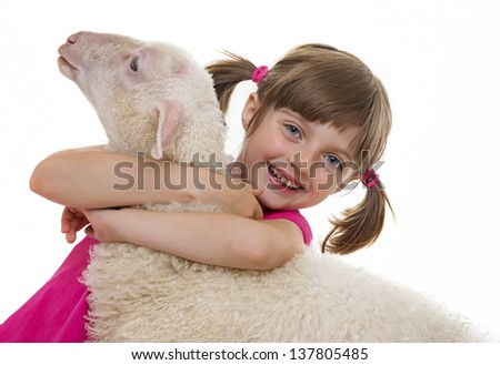 happy little girl with a sheep