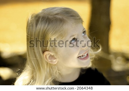 Happy little girl with autumn background - stock photo